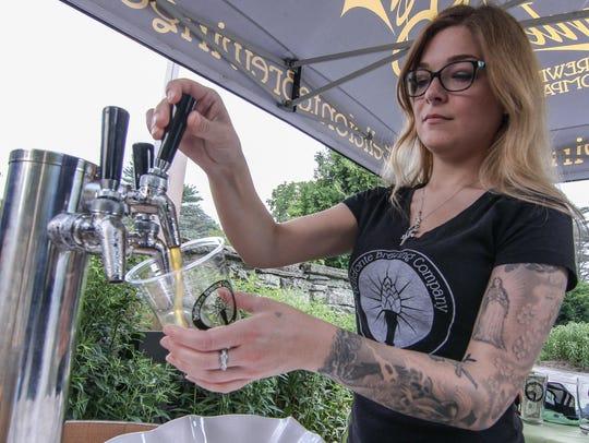 Rachel Sauer of Bellefonte Brewing Company pours a