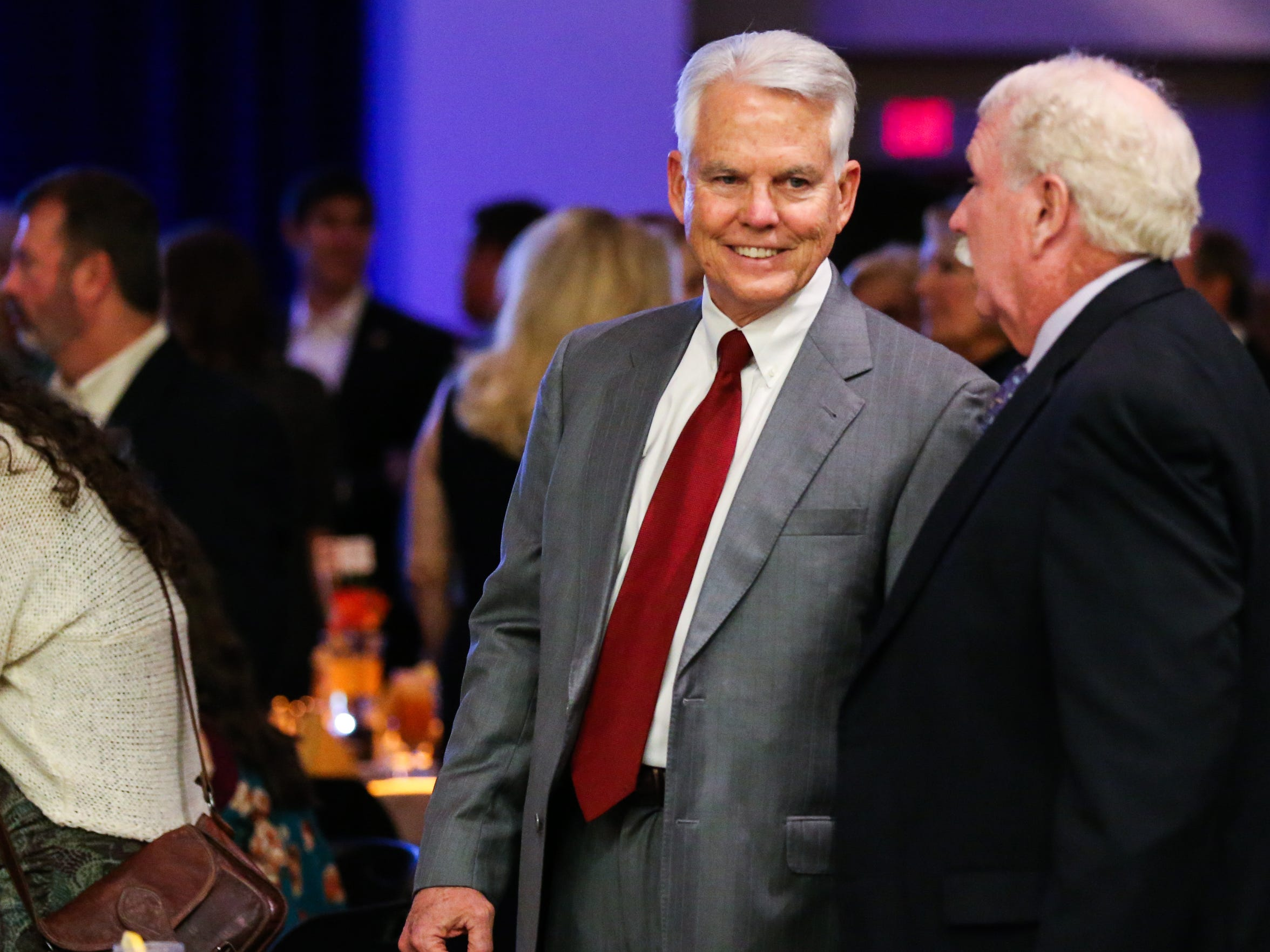 Max Parker chats with others during the 20 under 40