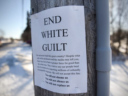 A sign is posted to a utility pole along Second Avenue