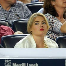 Aug 4, 2014; Bronx, NY, USA; American supermodel Kate Upton looks on from behind the Tigers dugout during the fourth inning of a game between the New York Yankees and the Detroit Tigers at Yankee Stadium. Mandatory Credit: Brad Penner-USA TODAY Sports
