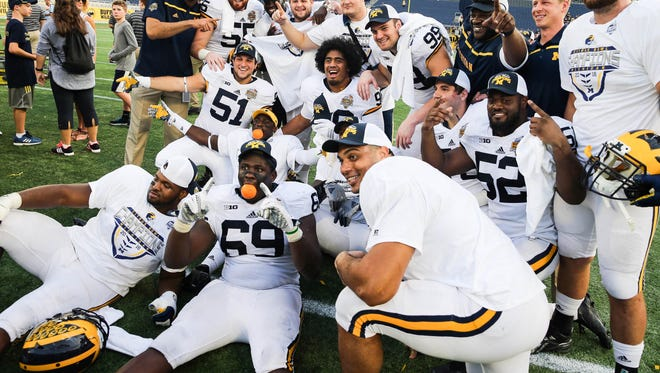 Michigan players celebrate after beating the Florida Gators in the 2016 Citrus Bowl at Orlando Citrus Bowl Stadium.