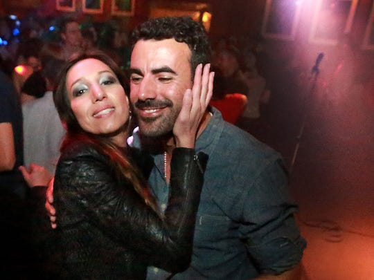 Artist and host Artur Silva, right, gets a greeting from friend Camila Cavalcante at the 2015 edition of Carnaval at the Jazz Kitchen.