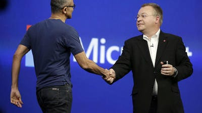 Microsoft CEO Satya Nadella, left, is greeted by Stephen Elop, right, executive vice president of Nokia, during the keynote address of the Build Conference Wednesday, April 2, 2014, in San Francisco. Nokia said Friday it has completed the 5.44 billion-euro ($7.5 billion) sale of its troubled cellphone and services division to Microsoft Corp.The closure of the deal, which includes a license to a portfolio of Nokia patents to Microsoft Corp., ends the production of mobile phones by the Finnish company, which had led the field for more than a decade, peaking with a 40-percent global market share in 2008.