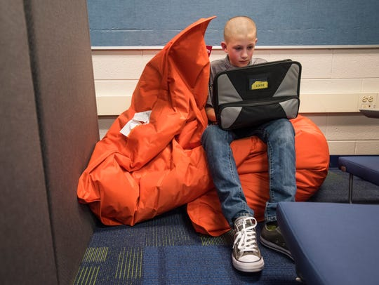 Lucas Spresser sits in a new bean bag chair Monday,