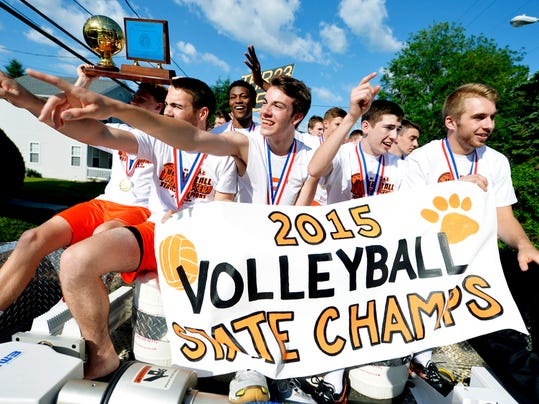 From left, Northeastern volleyball players Brandon Arentz (holding trophy), Matt Thornton, Jeff Reynolds, Philip White, Drew Landis and Reese Devilbiss ride on top of a Union Fire Company fire truck with their teammates through Manchester Borough after winning their third-straight PIAA Class AA boys' volleyball state championship on Saturday, June 6, 2015. The Bobcats swept Saegertown (25-9, 25-22, 25-12) and returned to a welcoming hometown crowd.