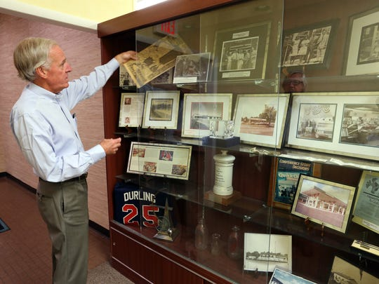 Dean Durling, the president of Quick Chek is photographed in his office at Quick Chek headquarters in Readington on Wednesday July 20, 2016.Here Durling shows some of the Quick Chek memorabilia that is on display at the company's headquarters.