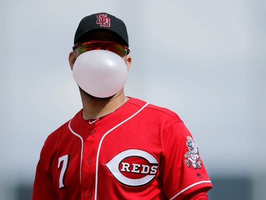 Cincinnati Reds third baseman Eugenio Suarez (7) blows a bubble with his gum as he paces in the bottom of the second inning of the Spring Training opening game between the Cleveland Indians and the Cincinnati Reds at Goodyear Stadium in Goodyear, Ariz., on Friday, Feb. 23, 2018.
