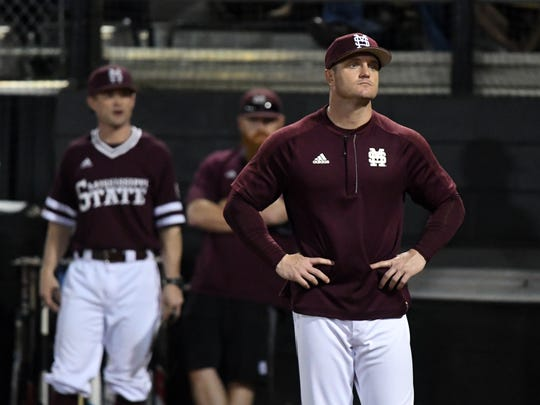 Mississippi State head coach Andy Cannizaro waits for the umpires in the season opener against Southern Miss on Friday at Pete Taylor Park.