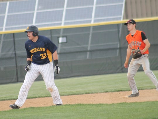 After swatting a double to the wall, Moeller's Mo Schaffer
