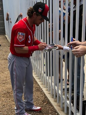 Reds second baseman and former Brewer Scooter Gennett signs autographs for fans at Maryvale Baseball Park on Tuesday.