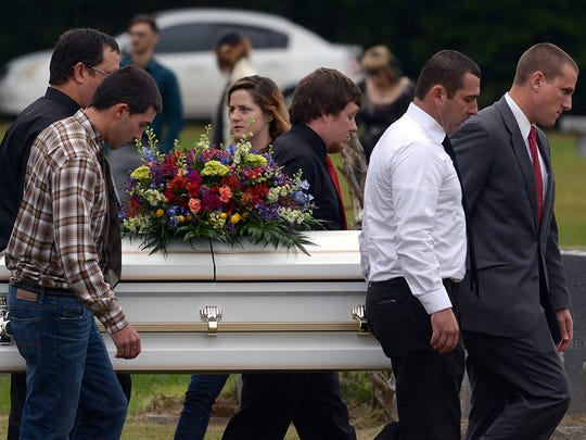 Pallbearers carry the casket of  6-year-old Jeremy