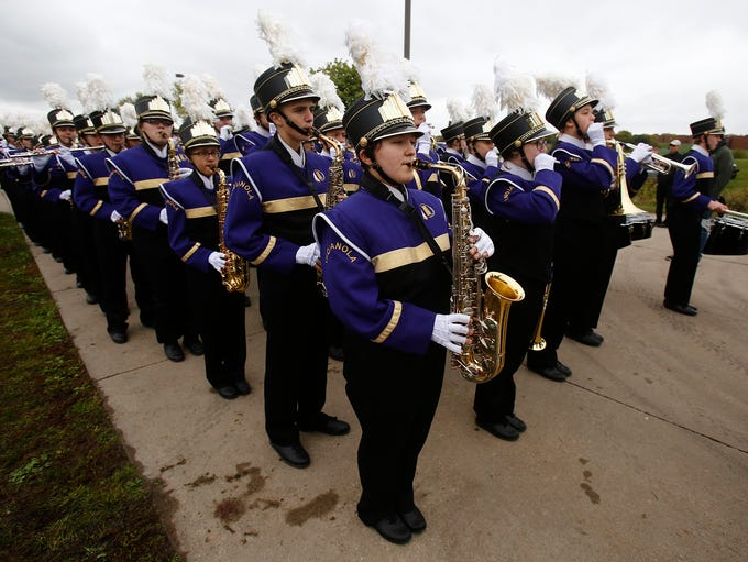 The Pride of Indianola Marching Band warms up before