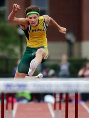 Freedom's Luke Pingel competes in the 300 meter hurdles