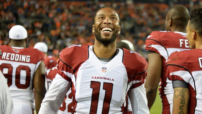 Sep 3, 2015: Arizona Cardinals wide receiver Larry Fitzgerald (11) reacts on his sideline in the fourth quarter of a preseason game against the Denver Broncos at Sports Authority Field at Mile High. The Cardinals defeated the Broncos 22-20.