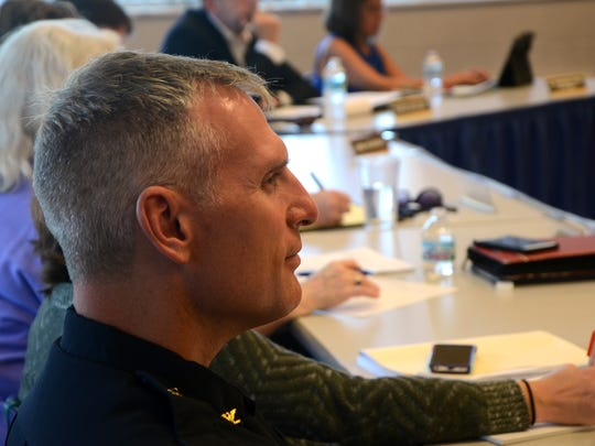 Police Chief Jim Blocker listens to concerns from residents about panhandling in Battle Creek. City commissioners may consider a set of ordinances to address the issue.