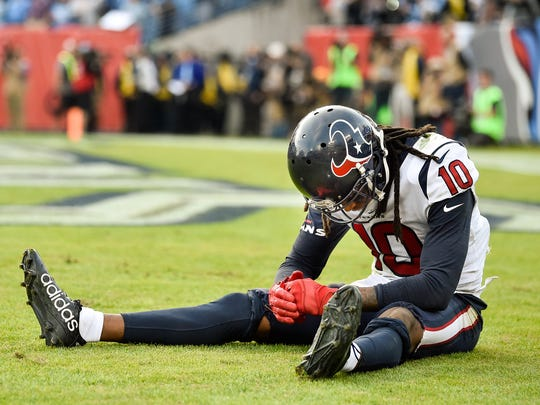 Texans wide receiver DeAndre Hopkins (10) reacts to an interception by Titans cornerback LeShaun Sims (36) during the second half at Nissan Stadium in Nashville, Tenn., Sunday, Dec. 3, 2017.
