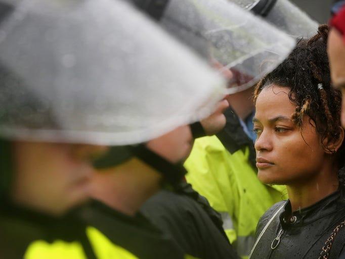 Demonstrators confront police outside the Ferguson