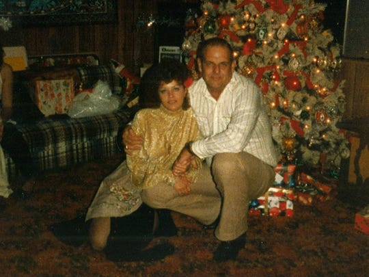 Sandi Martin, left, and Bob Martin, right, pose for a photo on Christmas, 1984. Martin was killed by Ernesto Martinez on Aug 15, 1995.
