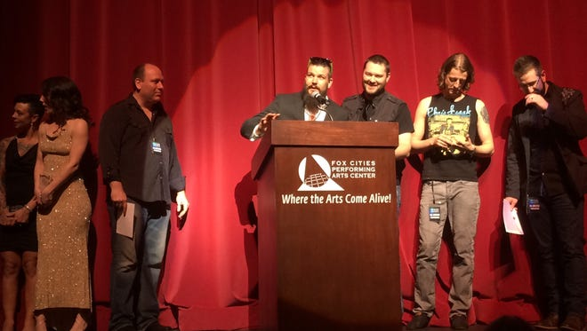 Red Light Saints accept the WAMI Award for Hard Rock/Metal in 2016.