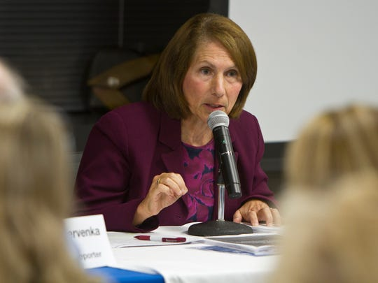 """New Jersey State Assemblywoman Amy Handlin answers questions regarding taxes at the """"Taxed Out"""" Town Hall."""