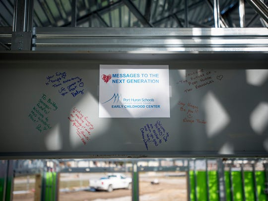 Port Huron Schools staff members wrote positive notes on one of the beams in the entrance to the Early Childhood Center Thursday. According to district officials, the center will be completed and ready for kids to start attending in September.