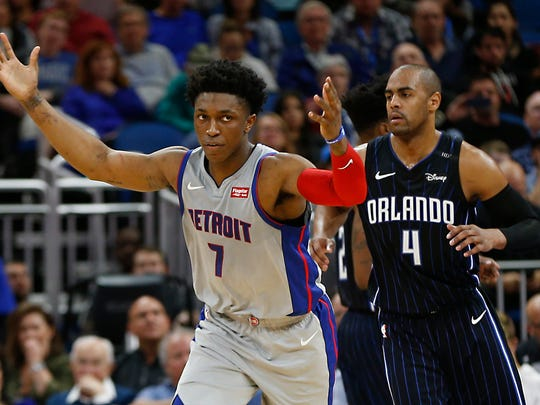 Detroit Pistons forward Stanley Johnson (7) reacts after scoring as Orlando Magic guard Arron Afflalo (4) follows behind during the second half at Amway Center.