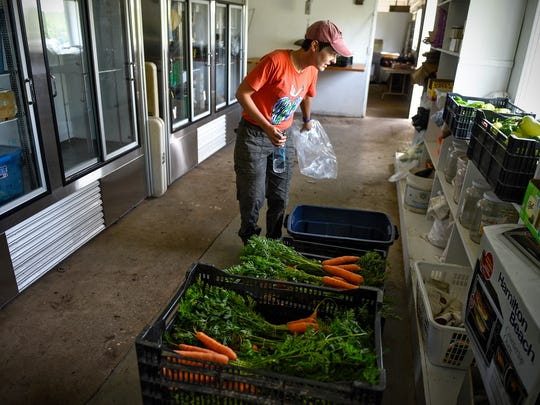 Kate Ritger views some of the fresh produce recently