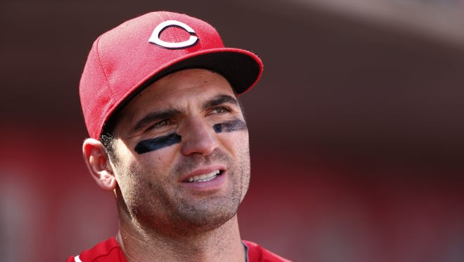 Cincinnati Reds first baseman Joey Votto (19) gets ready to rake the field against the Colorado Rockies at Great American Ball Park.