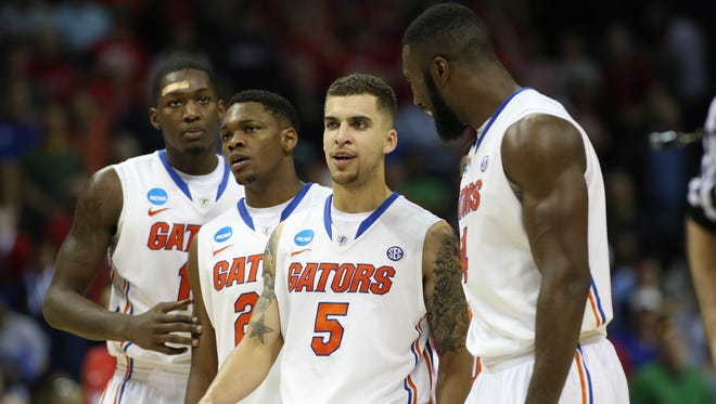 Florida Gators forward Dorian Finney-Smith (10), Michael Frazier II (20), Scottie Wilbekin (5) and Patric Young (4) during the second half against the Dayton Flyers of the final in the south regional.