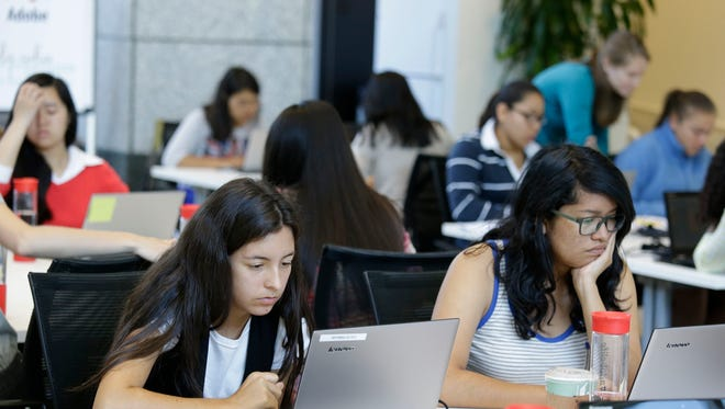 Bryanna Gilges, 15, left, and Yvonne Gonzalez, 17, right, work at completing an exercise during a Girls Who Code class at Adobe Systems in San Jose, Calif. on June 18, 2014. Girls Who Code is a national non-profit that aims to inspire, educate and equip young women for futures in the computing-related fields.