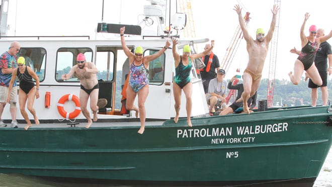 Swimmers and kayak guides start the 8 Bridges Hudson Valley Swim stage 6 between the Tappan Zee Bridge and the George Washington Bridge on June 24, 2014.