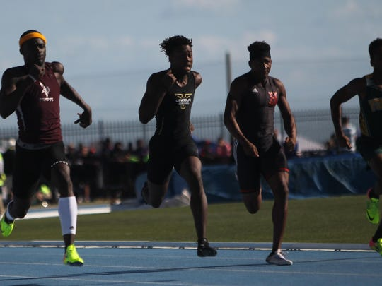 Lincoln senior Marquel Pittman races Miami Norland's Tyrese Cooper (far left) in the 200-meter dash. Pittman took home a silver medal.