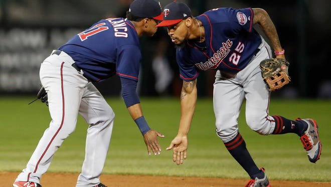 Minnesota Twins' Jorge Polanco (11) celebrates a win agains the Chicago White Sox with Byron Buxton (25) after game two of a baseball doubleheader, Monday, Aug. 21, in Chicago.