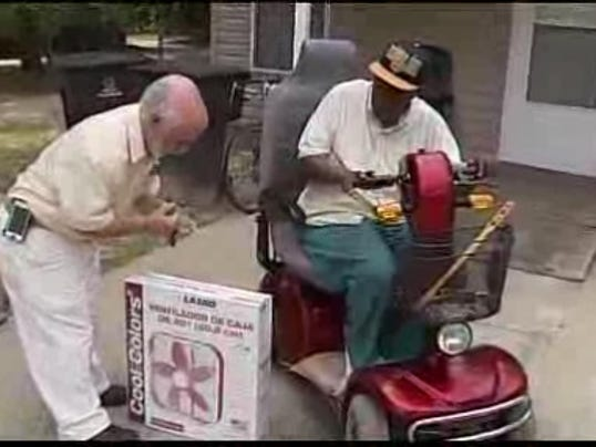 Ed Gines delivering fan to senior in Tallahassee.jpeg
