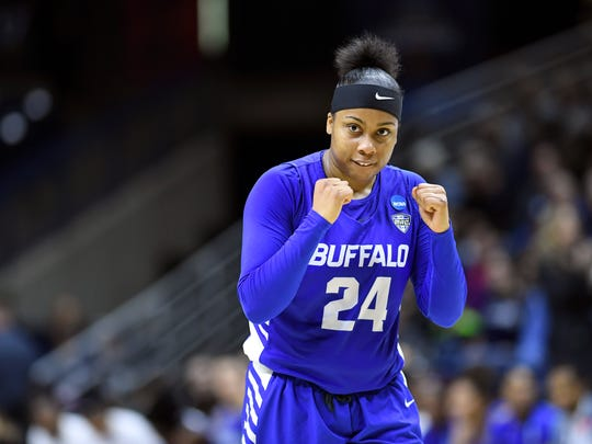 Buffalo's Cierra Dillard (24) pumps her fist at the buzzer after Rutgers in a first-round game in the NCAA women's college basketball tournament, Friday, March 22, 2019, in Storrs, Conn. (AP Photo/Stephen Dunn)