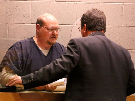 ASHLEY SMITH / STATESMAN JOURNALPeter Bass talks with his attorney Robert Botta during his arraignment in Salem, Ore. on Thursday. Peter Bass talks with his attorney Robert Botta during his arraignment at the Marion County Circuit Court Annex on Thursday, Jan. 22, 2015, in Salem, Ore.