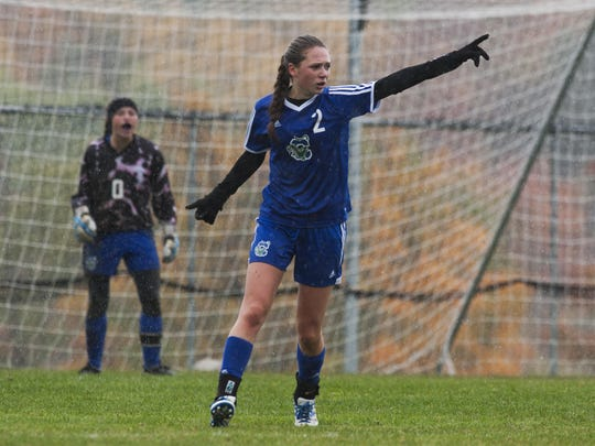 Colchester's Ani McMannon (2) points down the field