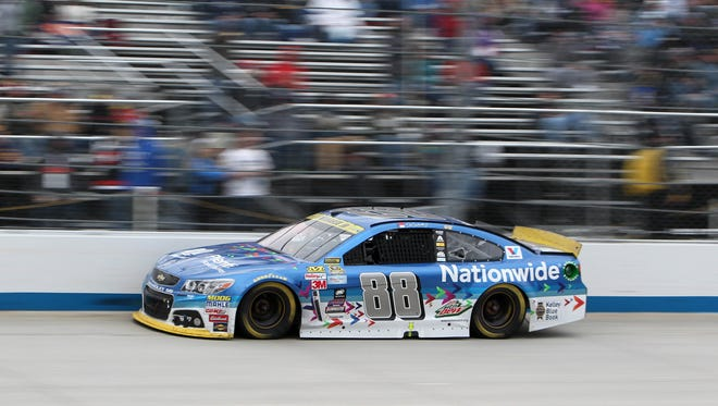 NASCAR Sprint Cup Series driver Dale Earnhardt Jr (88) races during the AAA 400 at Dover International Speedway.