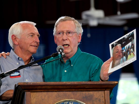 Sen. Mitch McConnell, right, held up a selfie photo taken with Governor Steve Beshear at last year's Fancy Farm speech where Beshear predicted that McConnell would retire after losing his senate run against Alison Lundergan Grimes.  McConnell reminded Beshear of the photo and said he would continue working as Beshear heads to retirement. Aug. 1, 2015I love this photo because turnabout is fair play and it is clear from the interaction of these two political rivals that they are not personal enemies.
