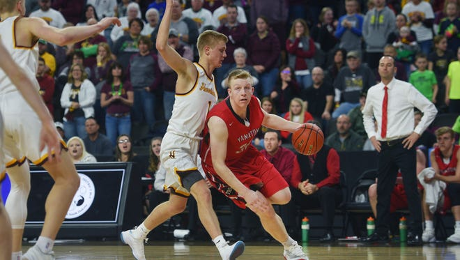 Harrisburg's Brady VanHolland defends Yankton's  Matthew Mors during the game Saturday, March 17, at the Denny Sanford Premier Center in Sioux Falls.