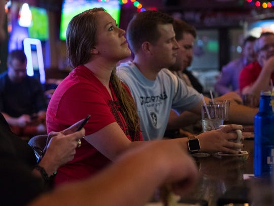 Danielle DeMent watches the Spain vs. Iran World Cup match at Gateway Lounge in Sioux Falls, S.D. on Wednesday, June 20, 2018.