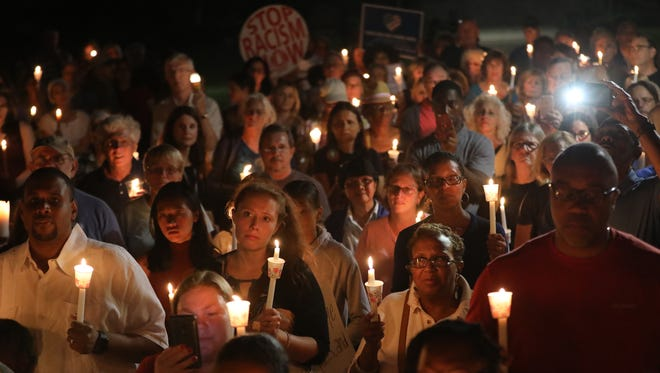More than 200 people gathered on the green in front of the Teaneck Municipal Building on August 13 to protest the weekend's violence in Charlottesville, Va.