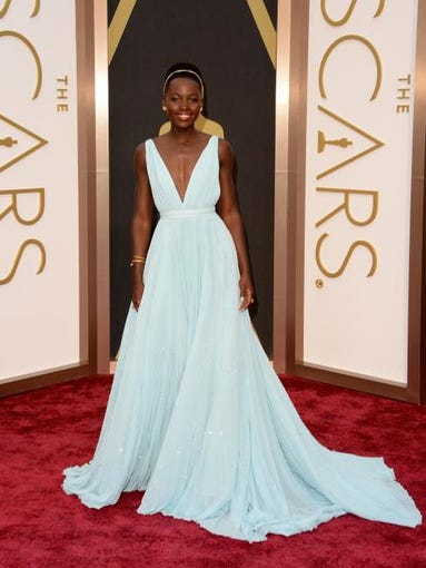 Oscars looks emphasized romantic embellishments, such as lace scalloping, peplum and a sparkly headband like the one worn by Best Supporting Actress winner Lupita Nyong'o.