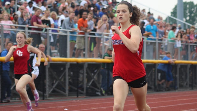 Hornell's Emma Flaitz nears the finish line in the 400 Friday at state qualifiers in Caledonia in a previous season. Flaitz has earned an LCAA scholarship.