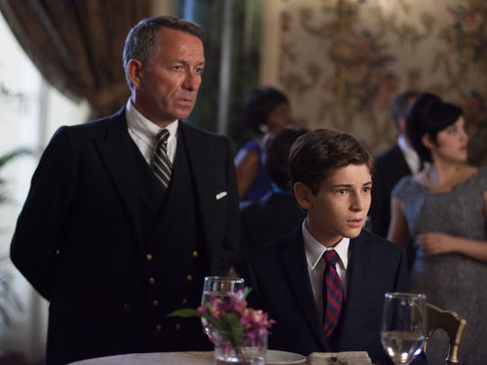 "Bruce Wayne (David Mazouz, right) and Alfred (Sean Pertwee) attend an event in the Fox television series ""Gotham."""