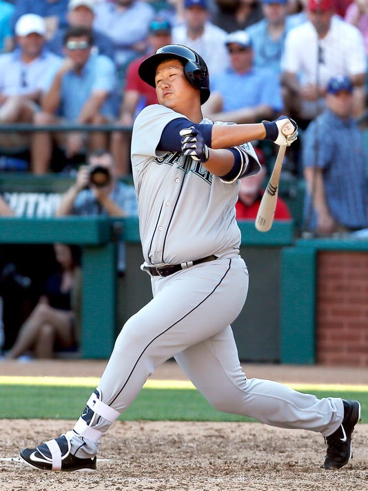 Seattle Mariners Dae Ho Lee (10) swings and misses during the seventh inning of a baseball game against the Texas Rangers, Monday, April 4, 2016, in Arlington, Texas. Texas won 3-2. Lee made is his MLB debut after spending 15 years playing professionally in Korea and Japan. (AP Photo/Brandon Wade)