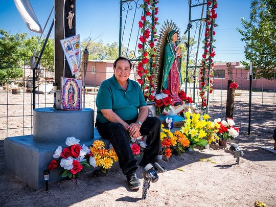 "City Councilman Joe ""Butter"" Milo sits by a memorial to lost immigrants he built in Deming, on Oct. 2, 2017. Milo's parents were first-generation immigrants from Mexico."