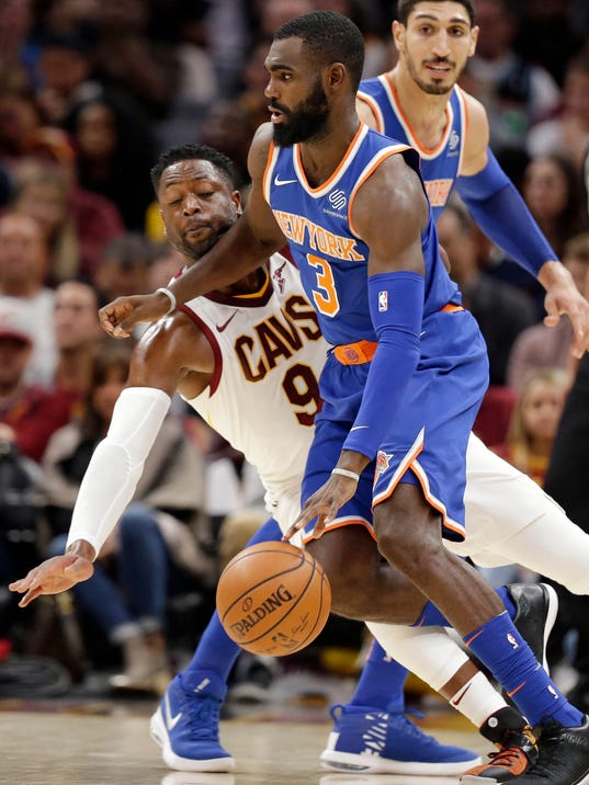 Cleveland Cavaliers' Dwyane Wade (9) fouls New York Knicks' Tim Hardaway Jr. (3) in the first half of an NBA basketball game, Sunday, Oct. 29, 2017, in Cleveland. (AP Photo/Tony Dejak)