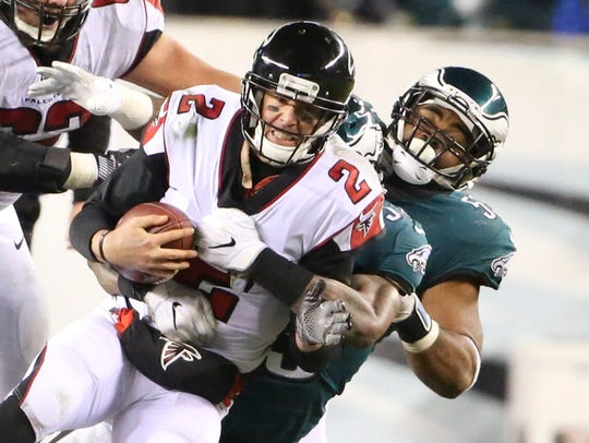 Atlanta quarterback Matt Ryan is sacked by Philadelphia's