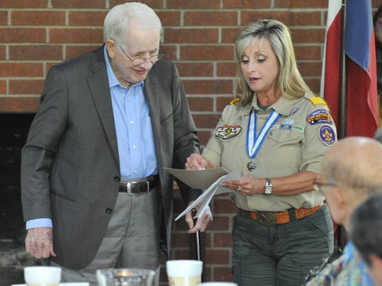 In this file photo, Northwest Texas Council Boy Scouts of America, executive council member, Adele Lewis, right, gives William Thacker Jr., a 50-year award.